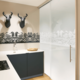 silhouette motif on glass back wall and glass door in silk grey glossy