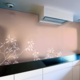 Flower pattern on glass back wall in champagne metallic gloss