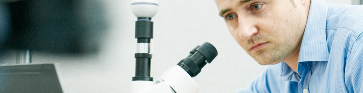 Product developer with microscope